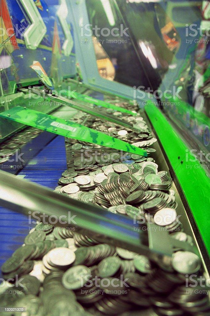 Quarter Push Machine in an Arcade royalty-free stock photo