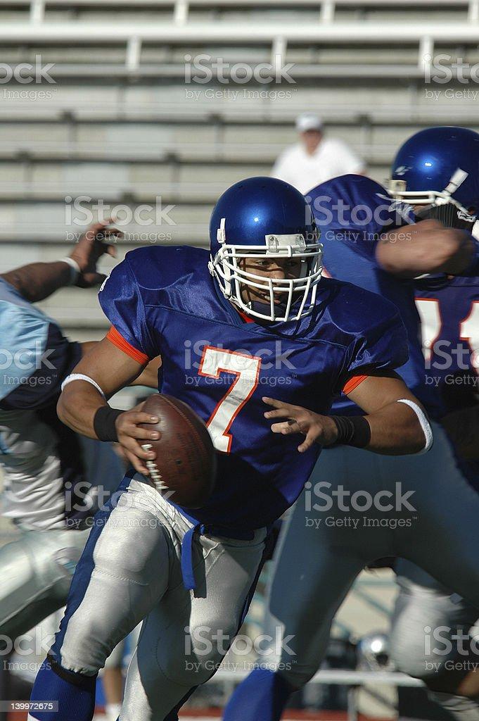 Quarterback Scramble stock photo