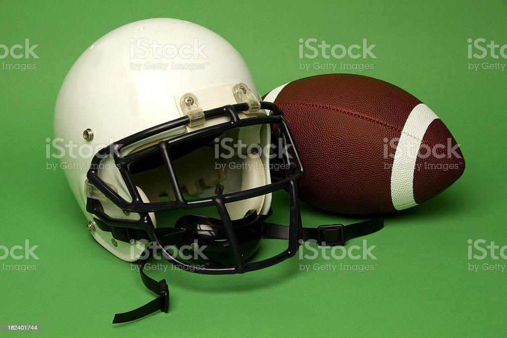 Quarterback's Helmet & Ball royalty-free stock photo
