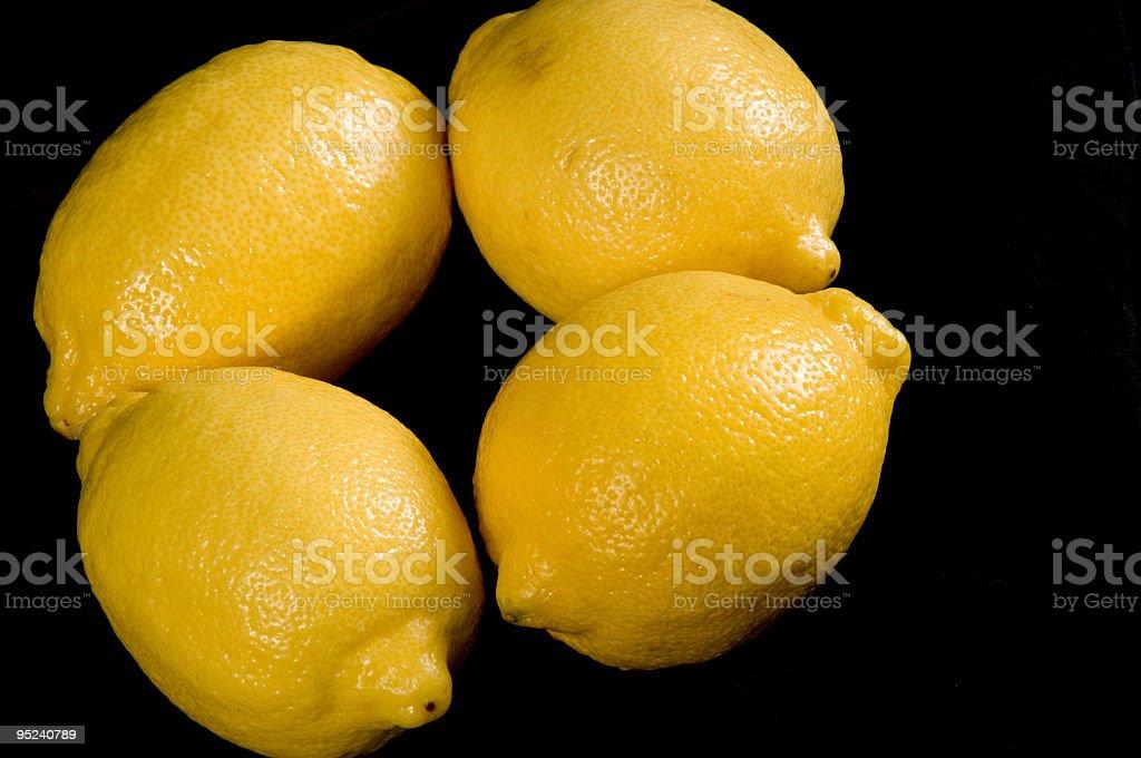 Quartet of lemons on black. stock photo