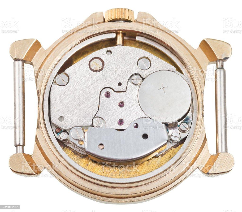 quartz clock mechanism in old golden watch stock photo