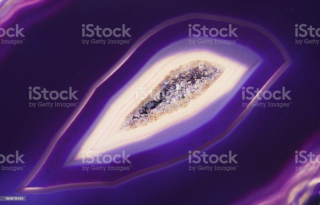 Quartz crystal inside of purple banded agate stock photo