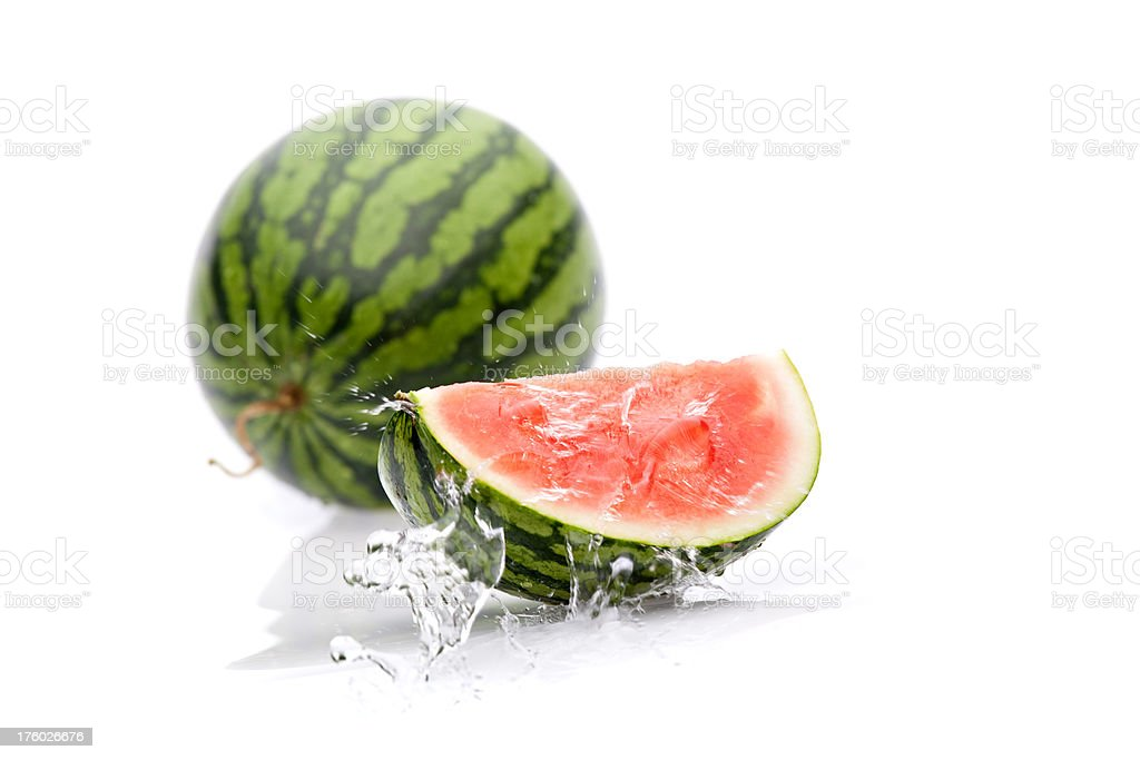 quater of melon with splashing water royalty-free stock photo