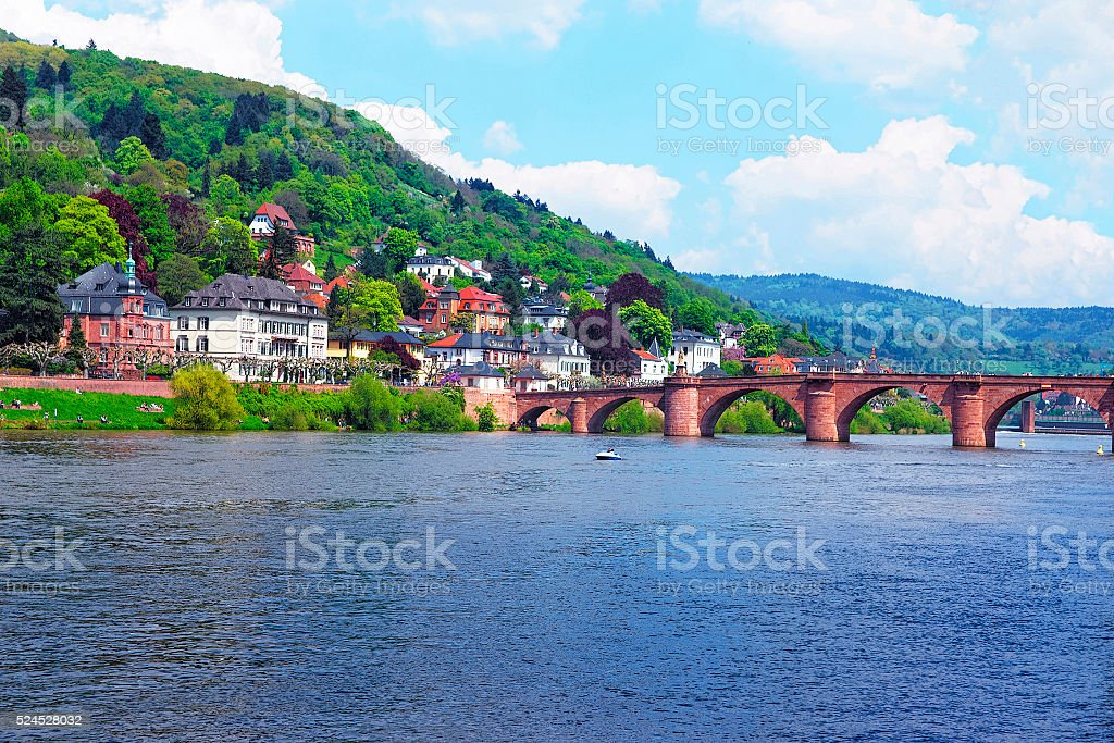 Quay of Neckar river and Old bridge in Heidelberg stock photo