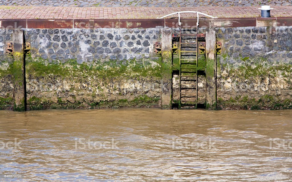 Quay with ladder and bolder stock photo