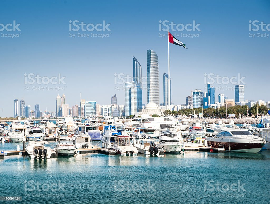 quay with yachts and skyscrapers stock photo