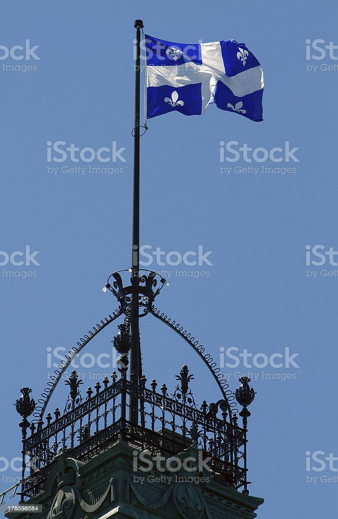 Quebec Flag Flying over tower royalty-free stock photo