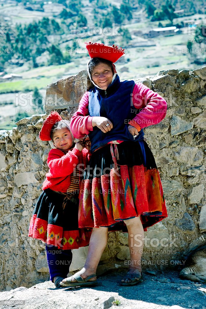 Quechua Indian woman and her daughter from the Patachancha Community stock photo