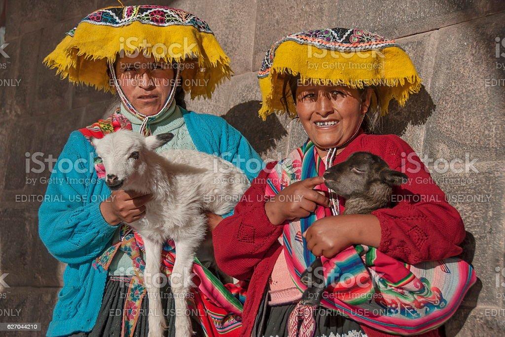 Quechua women pose for a photo in Cuzco, Peru. stock photo