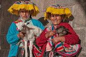 Quechua women pose for a photo in Cuzco, Peru.