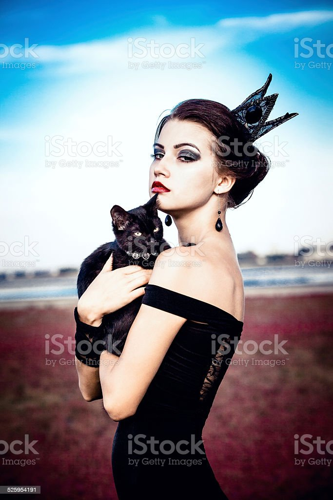Queen and cat stock photo