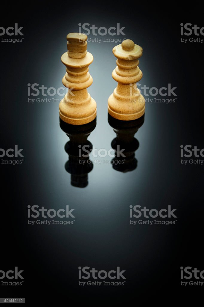 Queen and King Chess Pieces stock photo