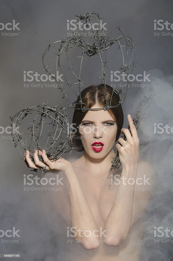 Queen in fog with symbols power of wire stock photo
