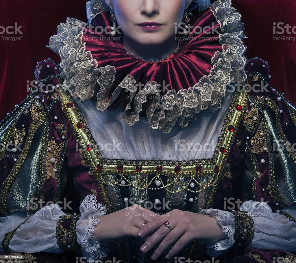 Queen in royal dress and luxuriant collar royalty-free stock photo
