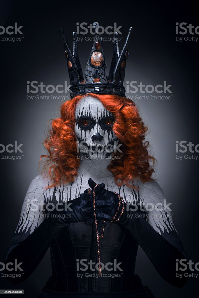 Queen of death, scary halloween female stock photo
