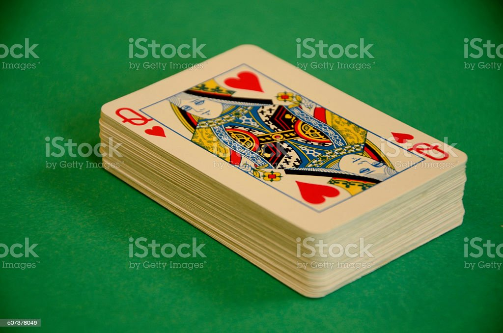 Queen of Hearts Deck of Playing Cards on Green Baize stock photo