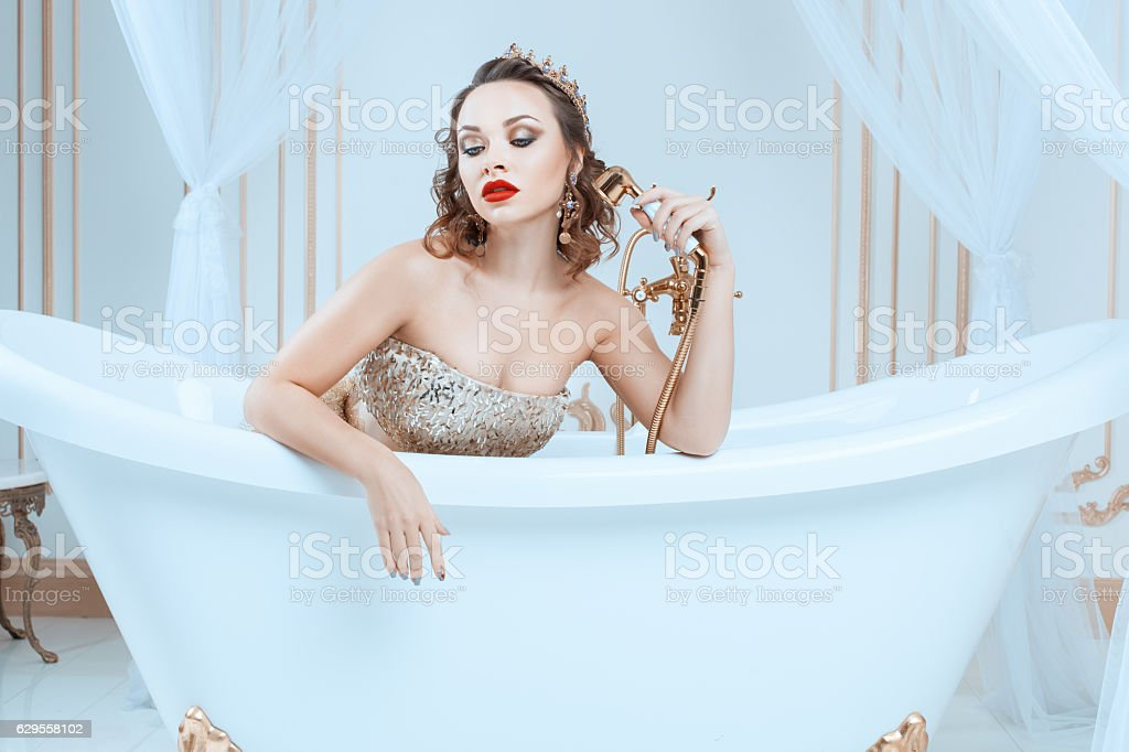 Queen sitting in the bath. stock photo