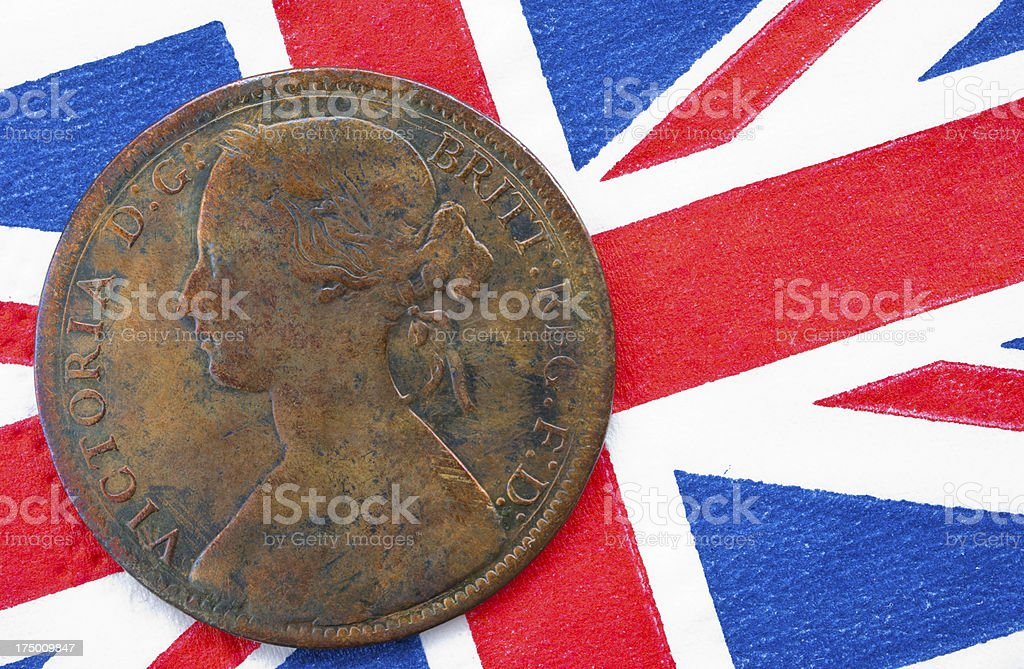 Queen Victoria one penny coin British flag background. royalty-free stock photo
