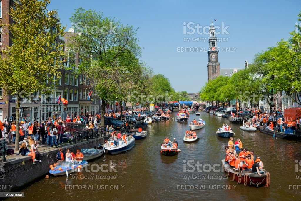 Queensday celebrations on the Prinsengracht canal in Amsterdam stock photo