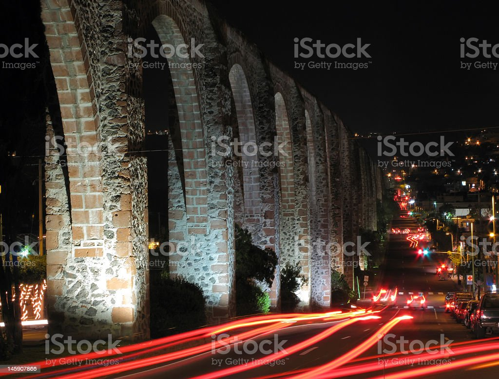 Queretaro Aqueduct with cars at night  stock photo