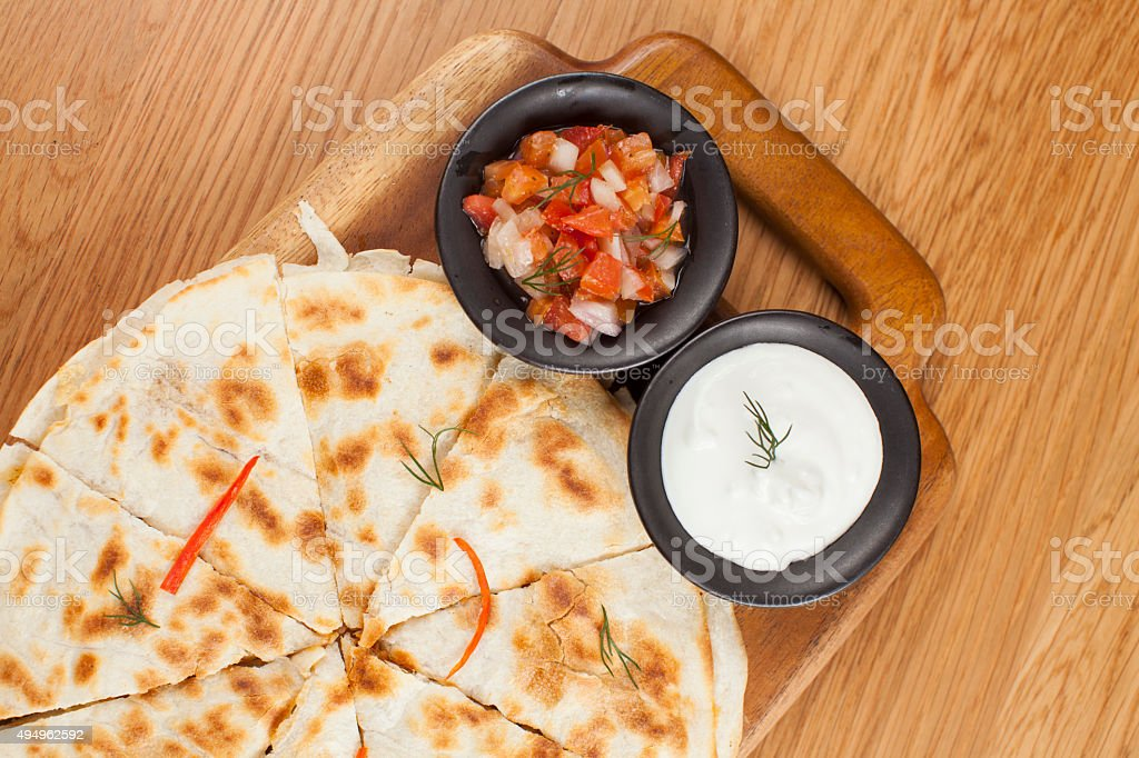 Quesadilla with salsa and sour-cream dipping sauce stock photo