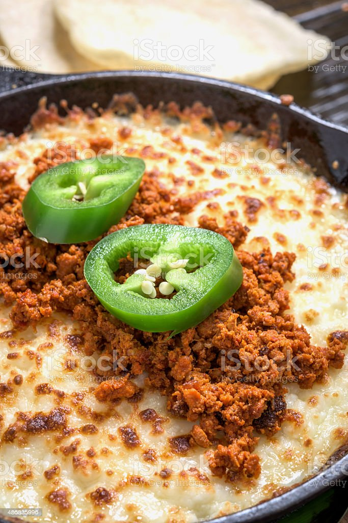 Queso Fundido (melted cheese dip) with  Chorizo stock photo