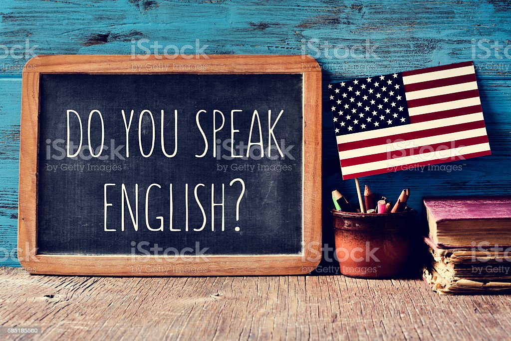 question do you speak English? in a chalkboard stock photo