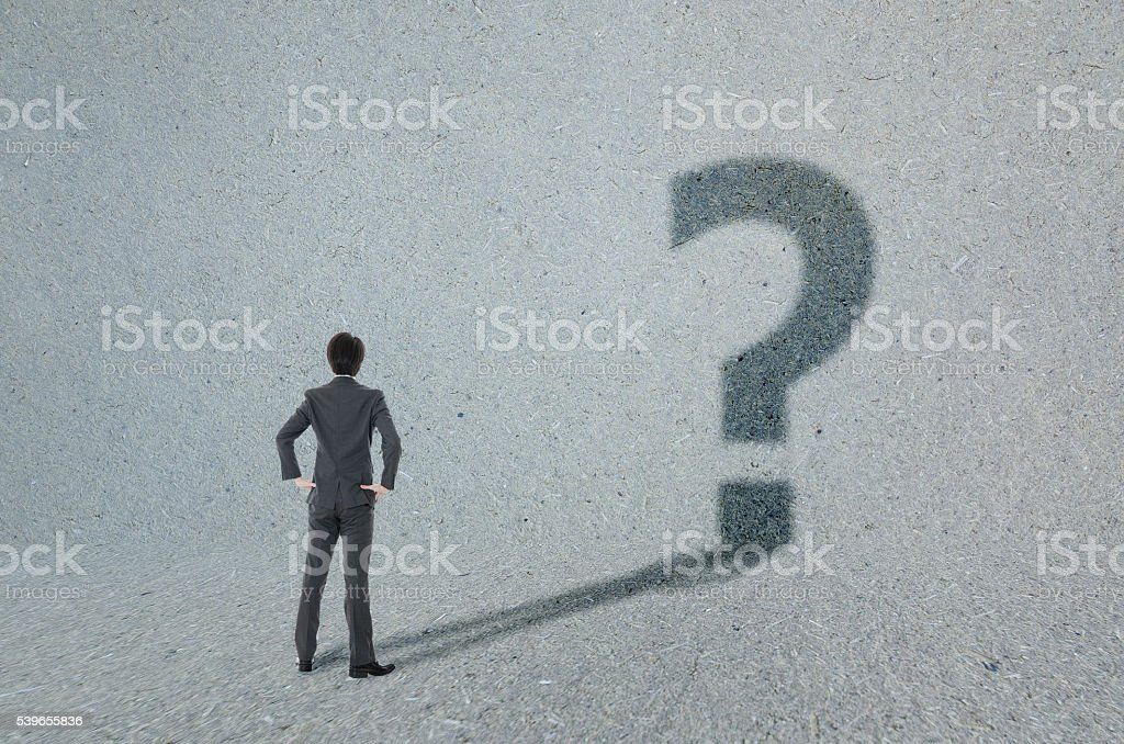Question mark and businessman stock photo