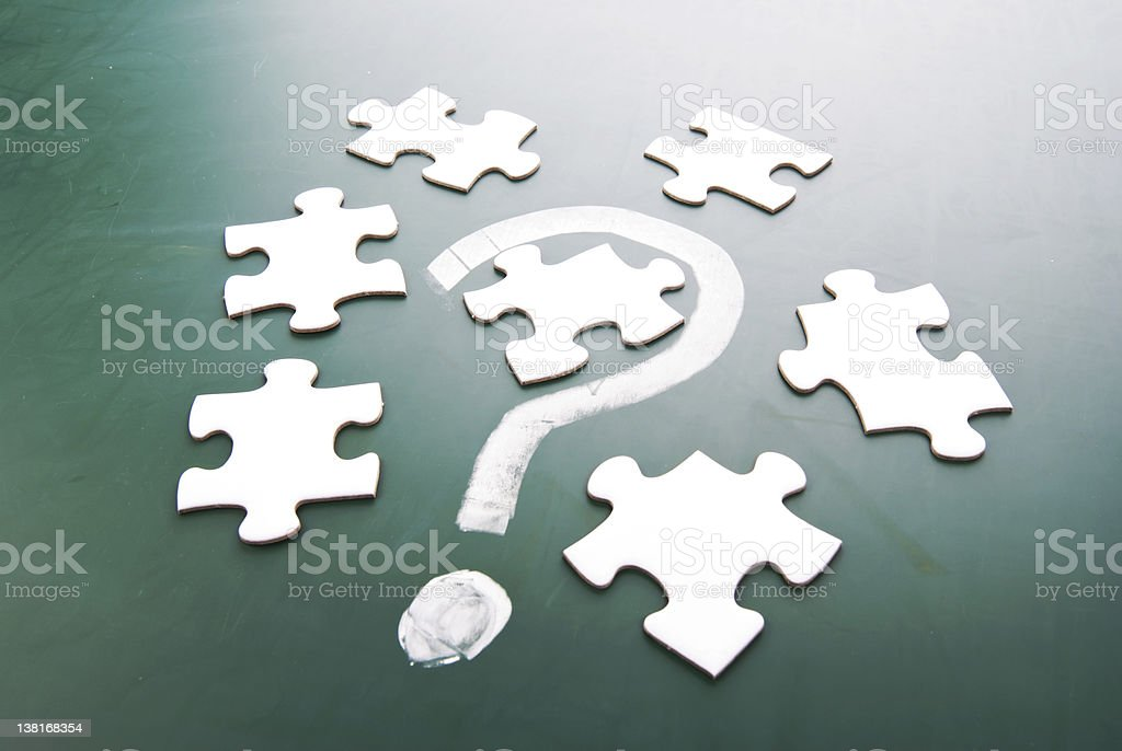 Question mark and puzzle pieces royalty-free stock photo