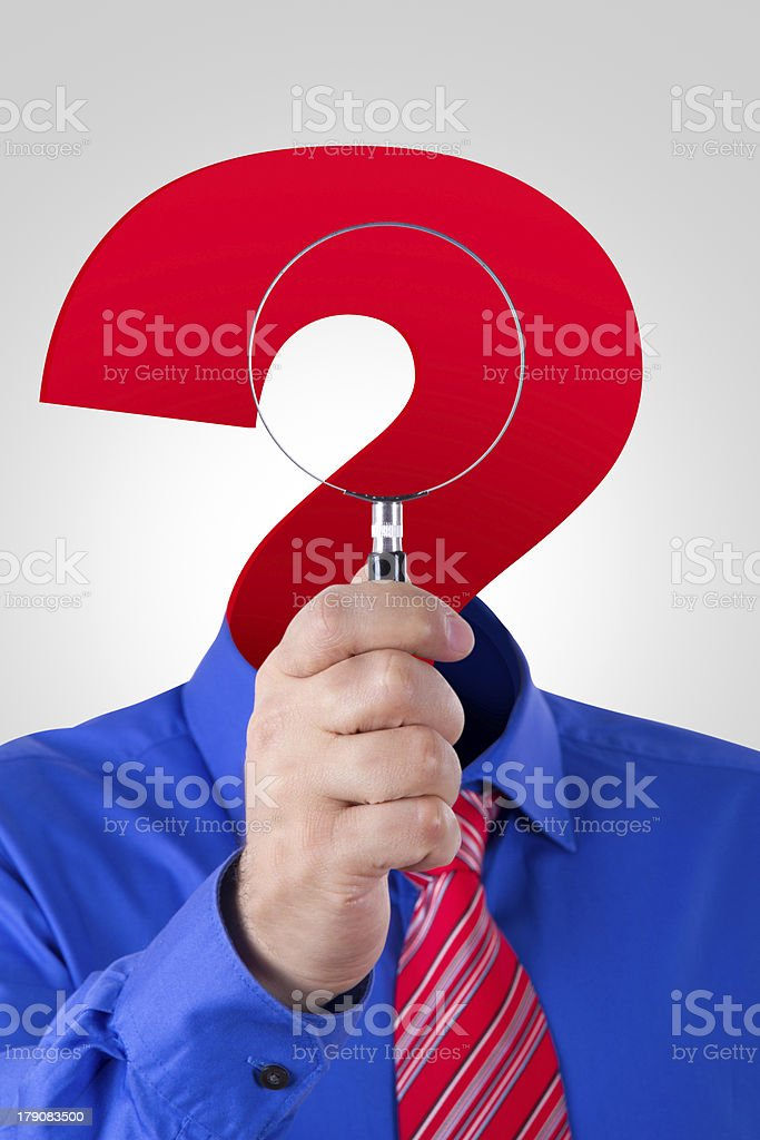 Question Mark Headed Man Holding Magnifying Glass royalty-free stock photo
