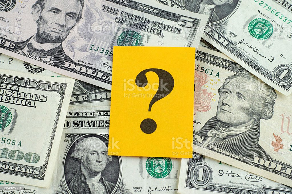 Question mark on dollar banknotes stock photo
