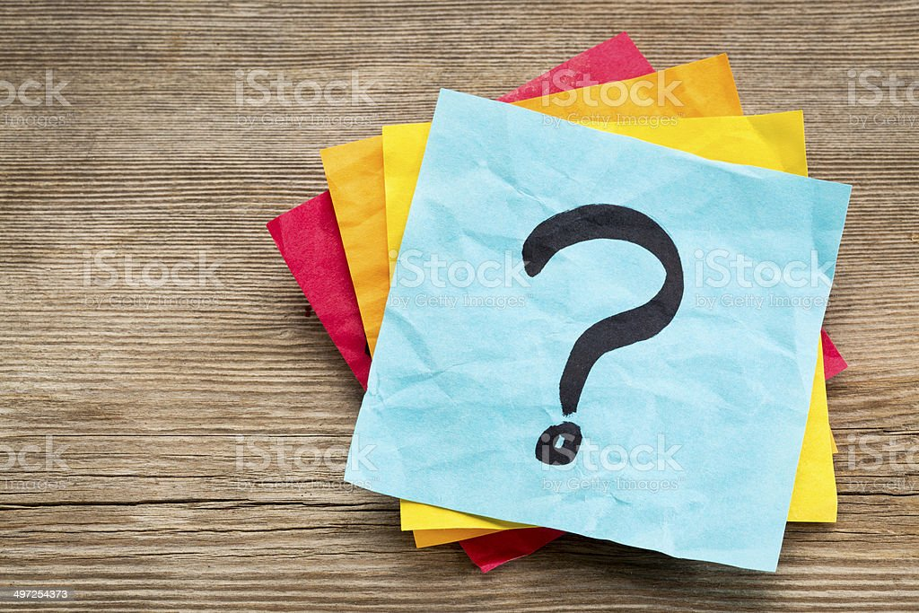 question mark on sticky note stock photo