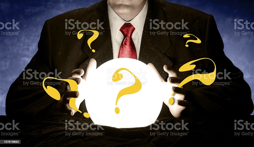 Question Marks from Glowing Crystal Ball stock photo