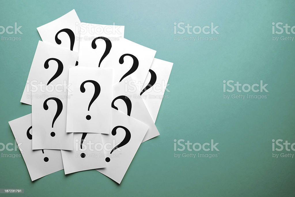 Question marks on paper royalty-free stock photo