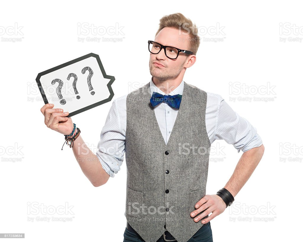 Question. Young man in classical outfit holding speech bubble stock photo