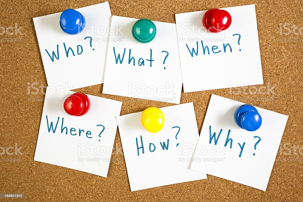 Questions for good stories posted on bulletin board with pushpins stock photo