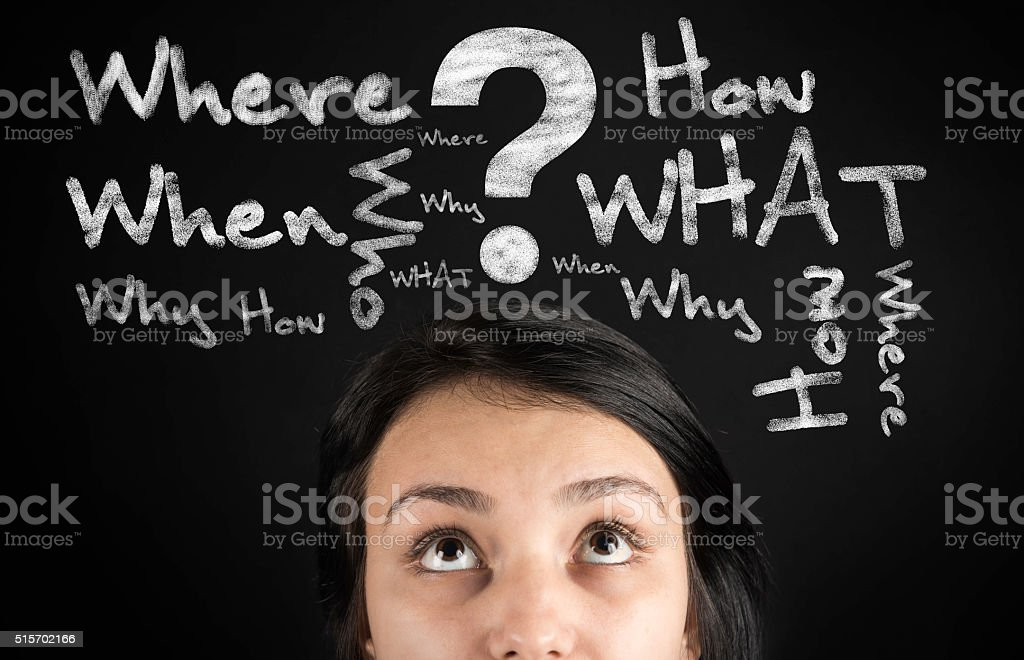 Questions in the young woman's head stock photo