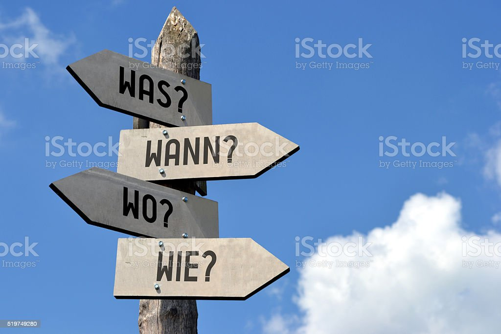 Questions signpost - in German stock photo