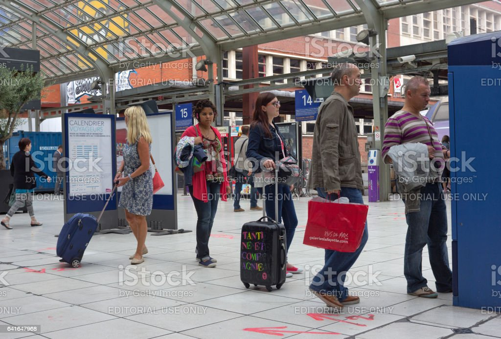 Queue to the ticket machine at railway station, Lille, France stock photo