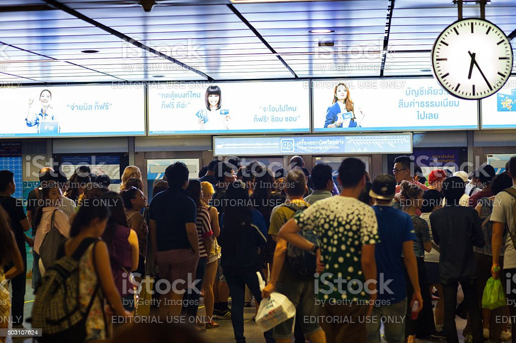 Queued crowd at ticketing machines of MRT stock photo