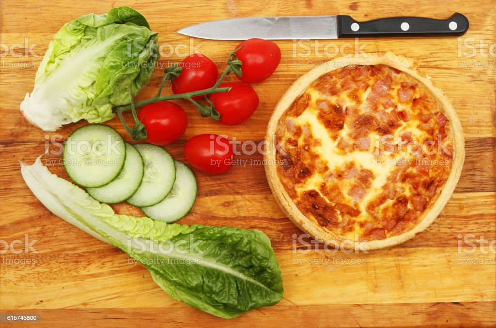 Quiche and salad on a board stock photo