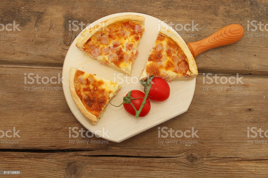 Quiche and tomatoes on wood stock photo