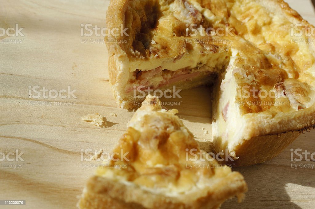 quiche lorraine on a kitchen table stock photo