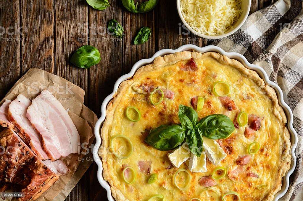 Quiche Lorraine with cheese, bacon and eggs stock photo
