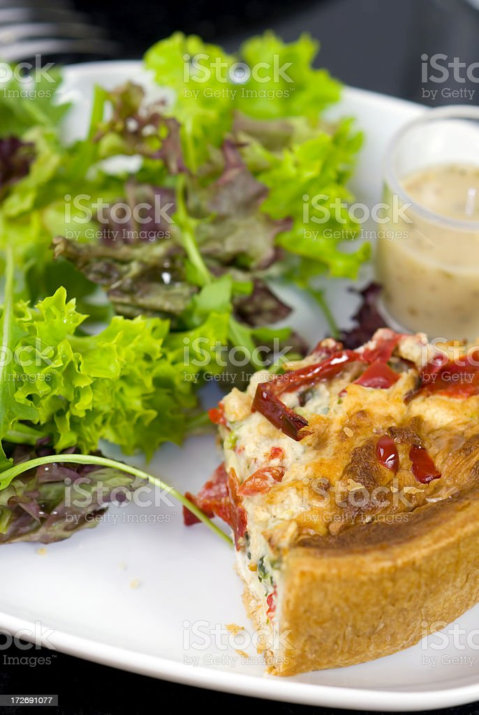 Quiche served with a mixed salad royalty-free stock photo