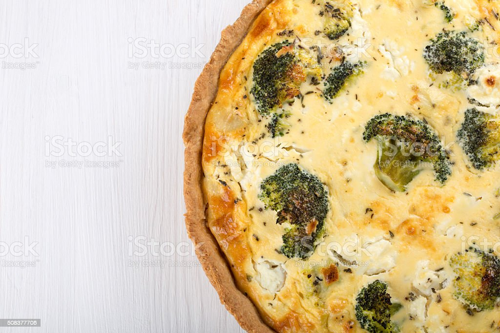 Quiche with broccoli and cheese stock photo