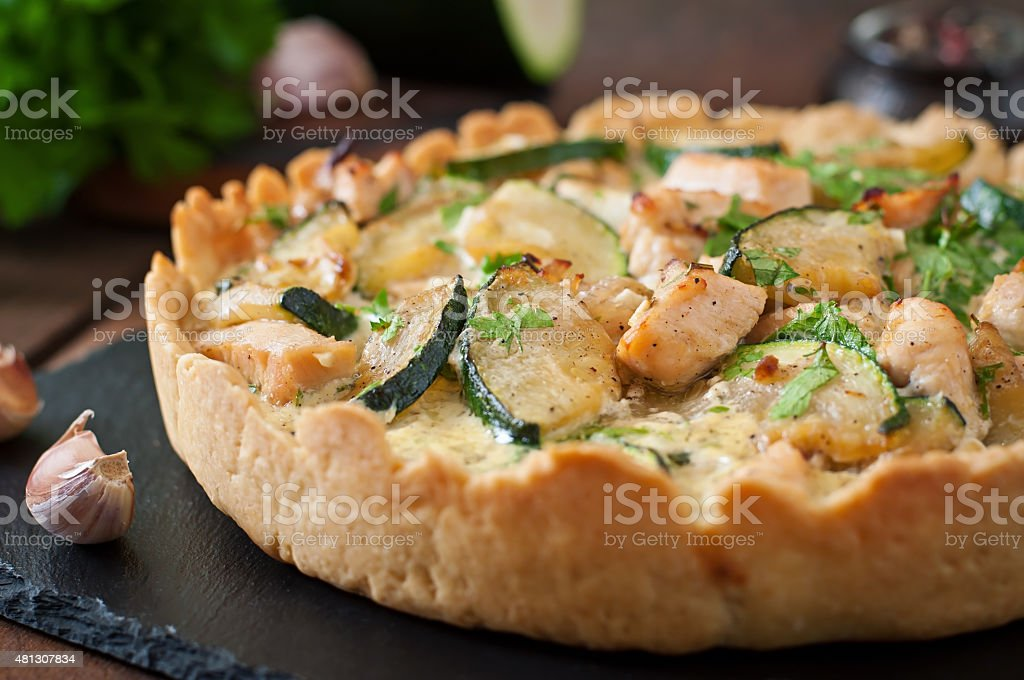 Quiche with chicken and zucchini with herbs stock photo
