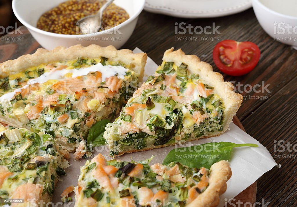 quiche with fish and spinach stock photo