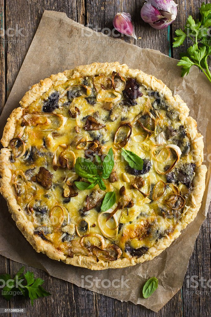 quiche with mushrooms, leek and cheese stock photo