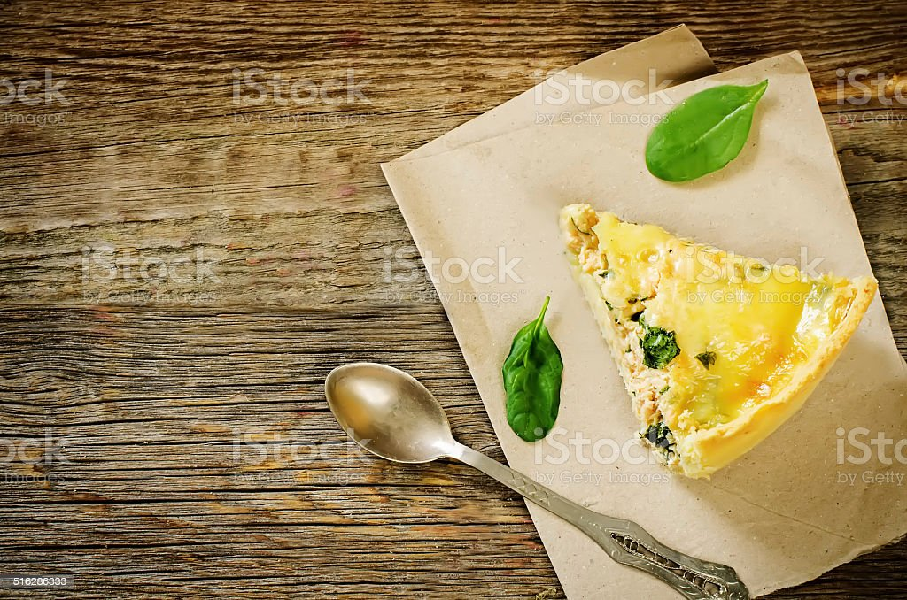 quiche with salmon and spinach stock photo